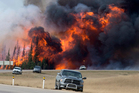 A wildfire burns south of Fort McMurray, Alberta. Photo / Jonathan Hayward /The Canadian Press via AP