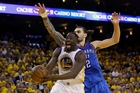 Golden State's Draymond Green drives past Steven Adams during the Warriors' big win in game two. Photo / AP