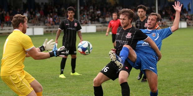 Dean Styles (right), pictured playing against Birkenhead United earlier in the season, scored Tauranga City's only goal against Central United on Saturday. Photo / Stuart Whitaker