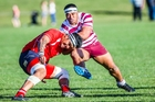 Taradale centre Leafi Tupuola charges into Napier Technical lock Elijah Martin during Saturday's 33-18 victory. Photo / Paul Taylor