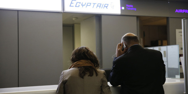 Loading People wait in front of the Egyptair desk at the Roissy-Charles De Gaulle airport in Roissy-en-France near Paris. Photo: Getty Images