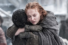 Jon Snow and Sansa Stark embrace after being reunited on Game of Thrones. Photo / HBO