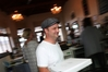 BUSY: Mark Schmid serves pizza in the La Familia cafe in central Whangarei. PHOTO/MICHAEL CUNNINGHAM