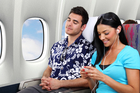 Give your seatmate a break and use headphones while watching that funny video clip. Photo / iStock