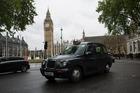 A London taxi cab passes Elizabeth Tower, home to Big Ben. Photo / Simon Dawson