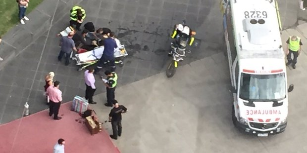 Emergency crews helping the woman onto a stretcher. Photo / Ahron Young Twitter