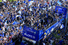 Leicester City players and staff celebrate with the trophy after winning the English Premier League during an open top bus parade through Leicester. Photo / AP