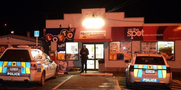 Police at the scene of a robbery in Brighton last night. Photo: Stephen Jaquiery/ODT