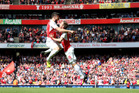 Arsenal's Olivier Giroud, left, celebrates with teammate Nacho Monreal after scoring their first goal. Photo / AP