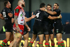 Alex Johnston of the Rabbitohs celebrates with team mates after scoring. Photo / Getty
