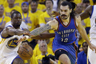Oklahoma City Thunder's Steven Adams fights for a loose ball against Golden State Warriors' Harrison Barnes. Photo / AP