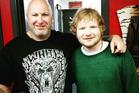 Tattoo artist Scott Mcfarlane with singer Ed Sheeran in Queenstown. Photo/Supplied