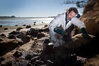 TOXIC: Mobil Oil spill clean-up on Rat Island.PHOTO/FILE