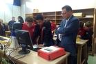 Matthew Jeffrey-Upsom, 14, and Kaea Bercic, 13, show Whangarei MP Shane Reti how they code.