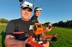 Tauranga drone racers Gary Hawkins and Jason Seaward show off their racing drones.