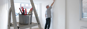 Painting a tired wall and having your house professionally dressed are quick ways to cheaply modernise the look.