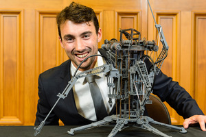 Scholarship recipient Napier's Hamish Beattie with the model he created to symbolise improvement in life quality for people who lived in parts of the world where home and income meant having to live in landfills.