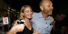 Australian television presenter Tara Brown and producer Stephen Rice arrive at Sydney International Airport. Photo / Getty Images
