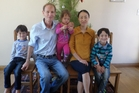Dr Sean Davison and his wife Raine Pen with their sons Flynn (left) and Finnian (right) and baby daughter Fia. Photo / Supplied