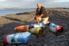 Jim Diggle, of Hastings, with some of the rubbish along Awatoto Beach, near Waitangi Reserve. Photo / Duncan Brown