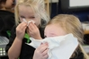 Meeanee School juniors Azariah Wright (left) and Leni Dean go through the safe way to sneeze and blow programme. Photo / Paul Taylor