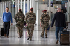 French soldiers patrol at Charles de Gaulle Airport, outside of Paris. Photo / AP