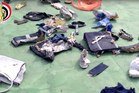 This still image taken from video posted on the official Facebook page of the Egyptian Armed Forces spokesman shows some personal belongings and other wreckage from the EgyptAir plane. Photo / AP