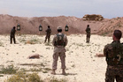 Syrian Arab trainees practice firing their small arms at an undisclosed training range in northern Syria. Photo / AP