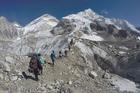 International trekkers pass through a glacier at the Mount Everest base camp, Nepal. Photo / AP