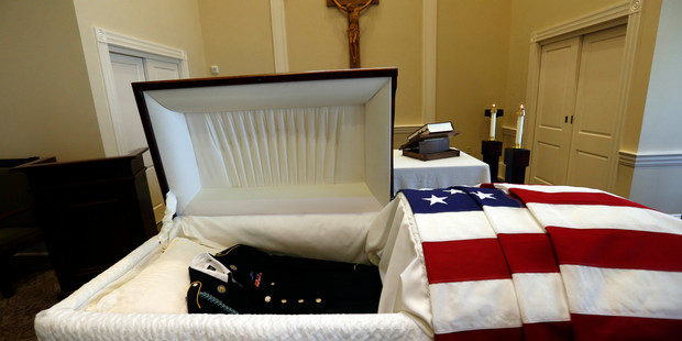 An army uniform lies in the casket containing remains of Army Private Earl Joseph Keating after it arrived at the Schoen Funeral Home in New Orleans. Photo / AP
