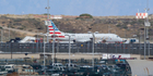 A jet sits on a remote stretch of runway at Los Angeles International Airport. American Airlines says officials screened the plane as a precaution. Photo / AP