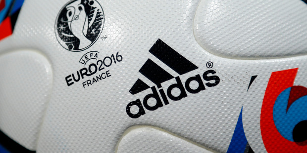The logo of German shoe and sports equipment company adidas AG is printed on the official UEFA Euro 2016 Cup football at the company's general meeting in Fuerth, Germany. Photo / AP