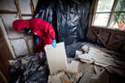 A crew from Building Remediation Services clear a house contaminated with P. Photo / Dean Purcell