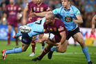 Queenslander Nate Myles gets an offload away during Game III of State of Origin last year. Photo / Getty Images