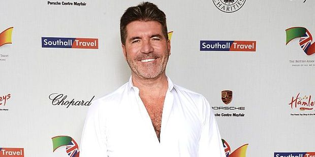 Simon Cowell admitted Eric will feature in the book, while there will also be a character based on himself. Photo / Getty Images