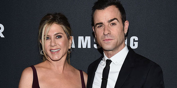 Jennifer Aniston with husband Justin Theroux. Photo / Getty Images