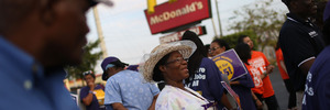 Demonstrators gather at a McDonald's in Florida to demand a minimum wage increase. Photo / Getty Images
