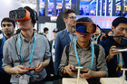 Visitors experience virtual reality and try out latest devices during the Consumer Electronics Show in  Asia earlier this month. Photo / Getty Images