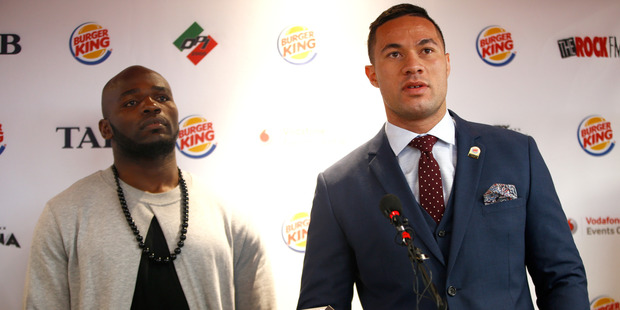Joseph Parker speaks alongside Carlos Takam during a press conference at Burger King. Photo / Getty Images
