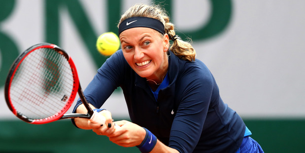Petra Kvitova hits a backhand during the Womens Singles first round match. Photo / Getty Images