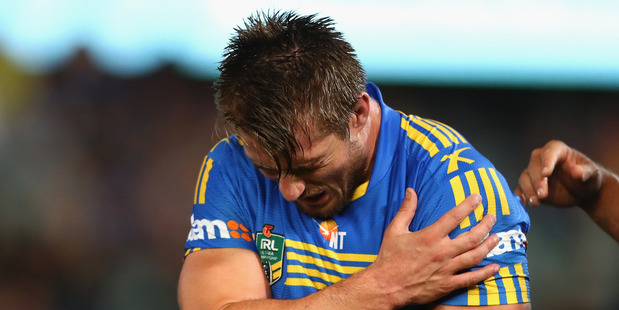 Parramatta Eels star Kieran Foran winces at a shoulder injury sustained in last nights 18-6 loss to the Melbourne Storm last night. Photo / Getty Images