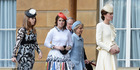 Princess Beatrice and Princess Eugenie were giving Catherine, Duchess of Cambridge, what would appear to be some rather chilly looks. Photo / Getty Images