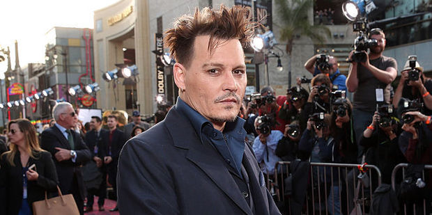 """Johnny Depp was a """"greasy mess"""" at premiere OAlice Through The Looking Glass. Photo / Getty Images"""