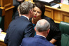 Finance Minister Bill English delivers a copy of the budget to Social Housing Minister Paula Bennett. Photo / Getty Images