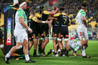 Brad Shields of the Hurricanes is congratulated on his try. Photo / Getty