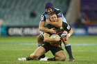 Dean Mumm of the Waratahs tackles Nathan Harris of the Chiefs. Photo / Getty
