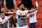 Joshua Addo-Carr of the Tigers celebrates scoring a try against the Brisbane Broncos. Photo / Getty
