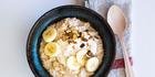 Porridge with yoghurt peanut butter honey swirl and banana