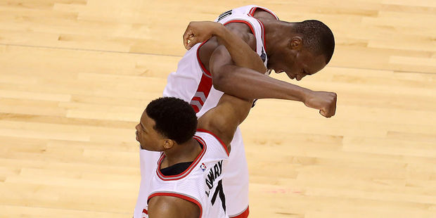 Toronto Raptors Kyle Lowry and Bismack Biyombo celebrate late in game four against the Cleveland Cavaliers. Photo / Getty