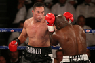 Joseph Parker and Carlos Takam trading blows. Photo / Photosport.co.nz